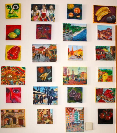 24 daily paintings displayed together on a wall
